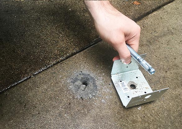 we used a hammer drill to drill holes into the cement